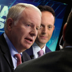 "In this Nov. 17, 2014 file photo, Allergan CEO David Pyott, left, and Actavis CEO Brenton Saunders, are interviewed on the floor of the New York Stock Exchange. Pyott is set to rake in an estimated $100 million in ""golden parachute"" payments, according to a study done by pay-tracking firm Equilar at the request of The Associated Press. The Associated Press"