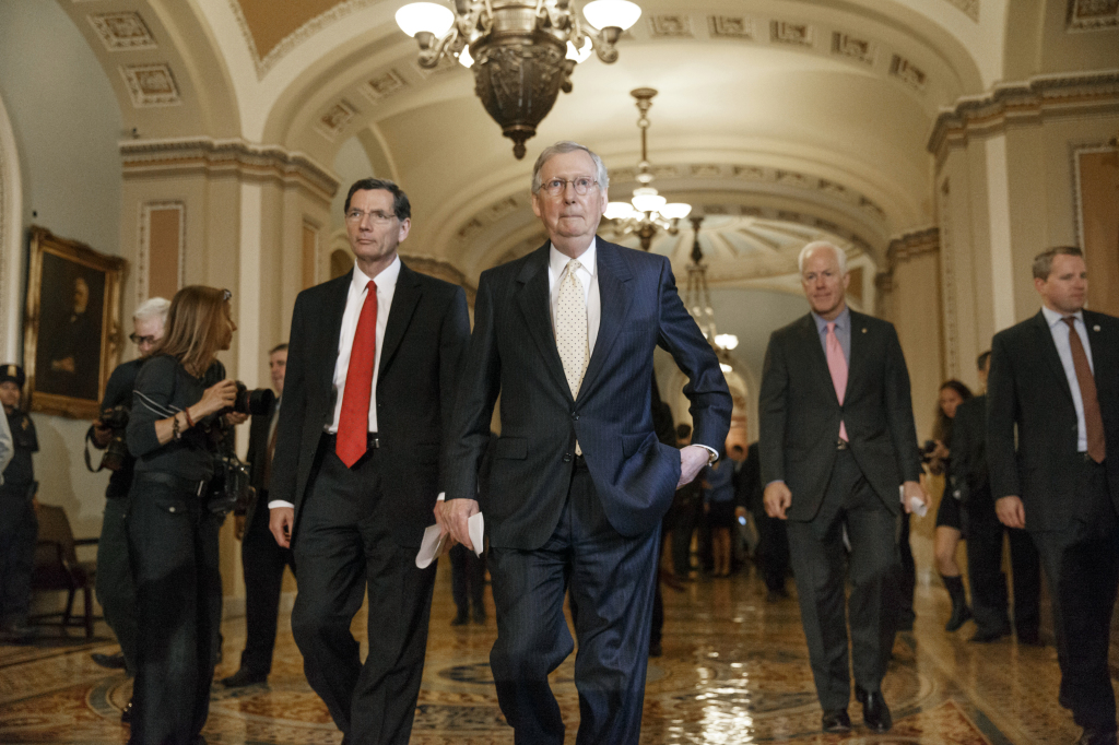 Senate Minority Leader Mitch McConnell of Kentucky, center, flanked by Sen. John Barrasso, R-Wyo., left, and Senate Minority Whip John Cornyn of Texas, right, arrive for a news conference on Capitol Hill in Washington. All along, the biggest question this election was whether Republicans could take over the Senate and add it to their solid House majority.