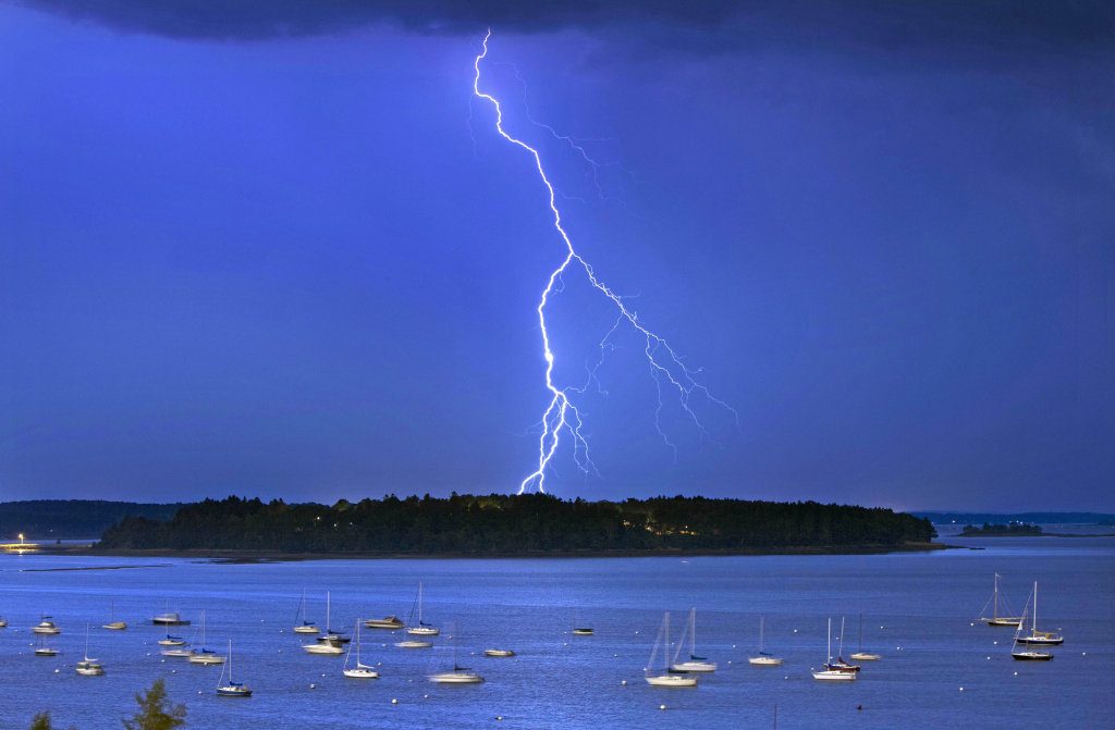 Lightning strikes north of Macworth Island in Portland. A new study says flashes of lightning in the U.S. will likely increase by nearly 50 percent by the end of the century because of climate change.