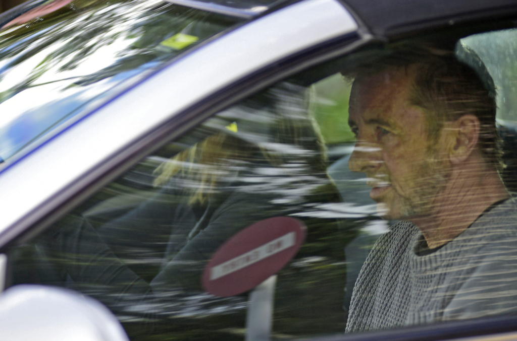 Phil Rudd, the drummer for rock band AC/DC, leaves a courthouse in Tauranga, New Zealand, Thursday after being charged with attempting to procure murder. The 60-year-old has also been charged with threatening to kill and possession of methamphetamine and marijuana.