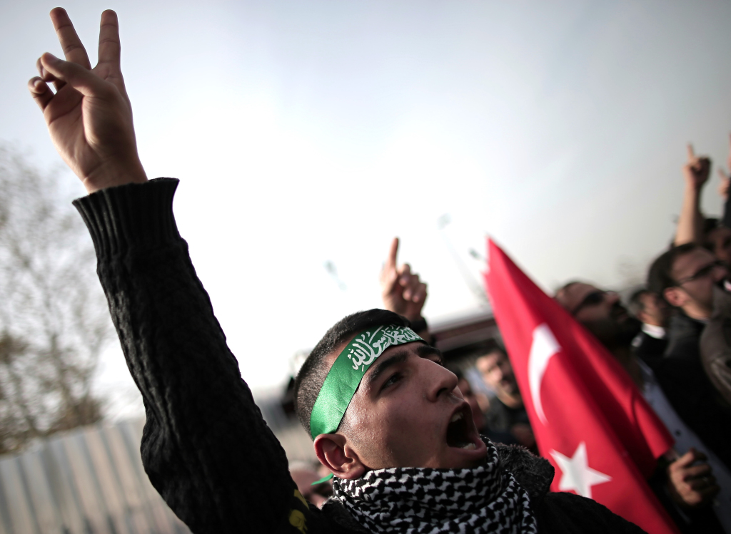 A pro-Palestinian Turk shouts slogans during a protest against Israeli restrictions at the Al-Aqsa Mosque in Istanbul, Turkey, on Friday. Other protesters who object to a U.S. presence in the region roughed up three American sailors Wednesday.