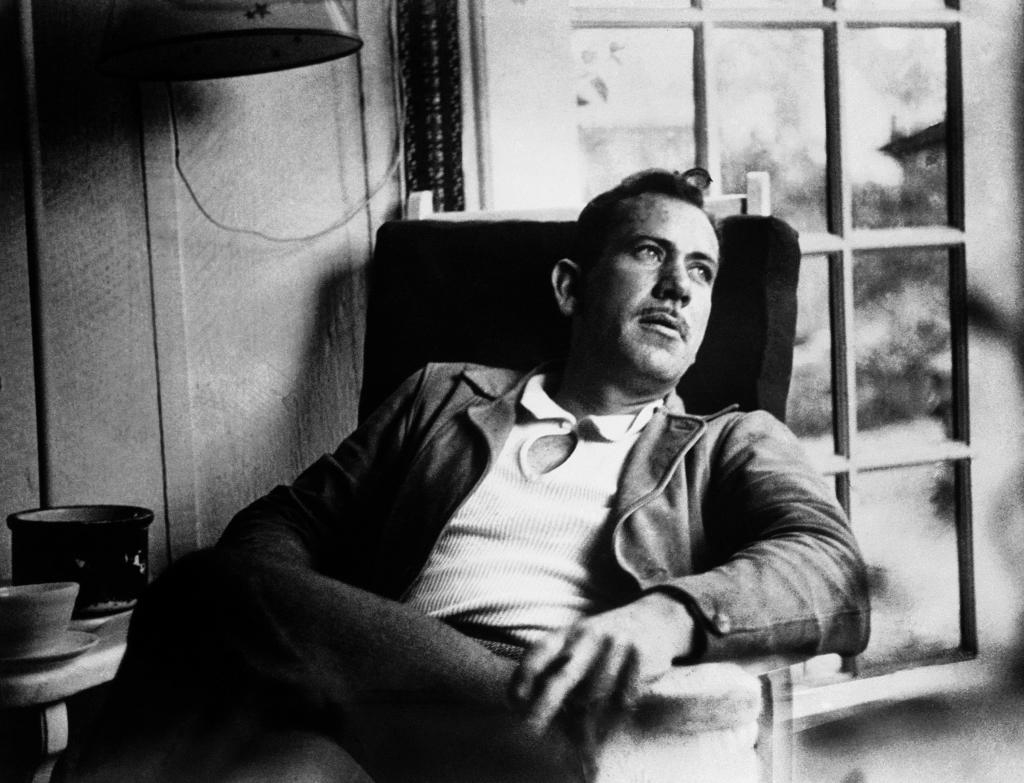 In this undated file photo, American author John Steinbeck, takes a rest from work on a new novel.