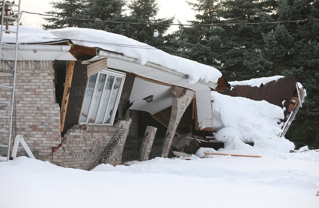 A collapsed home in Alden, N.Y.