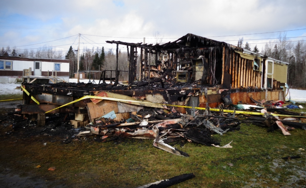 Damage is extensive to the mobile home where a mother and her three children were killed in a fire Thursday in Caribou.