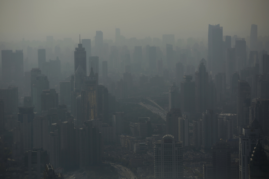 Shanghai's smog-shrouded skyline as seen from the Shanghai Financial Center building on Oct. 23, 2014. China, whose emissions are growing as it builds new coal plants, has set a target for its emissions to peak by about 2030 — earlier if possible. Reuters