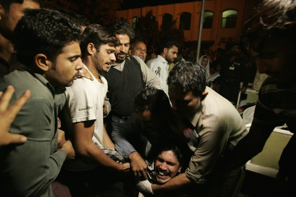 A Pakistani man mourns the death of a relative who was killed in the suicide bomb attack in Wagah, near Lahore, on Sunday. Reuters