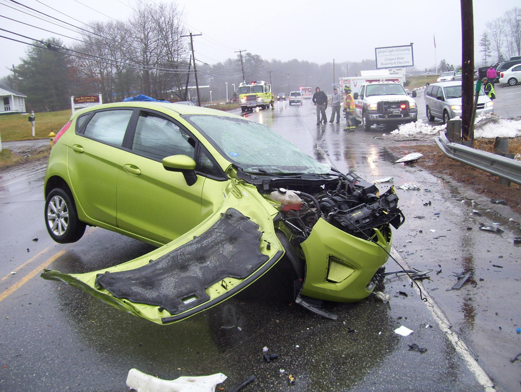 "The driver of this Ford Fiesta was taken to Maine Medical Center in Portland with ""significant injuries"" after a collision with a school bus, while a passenger was taken to a local hospital."