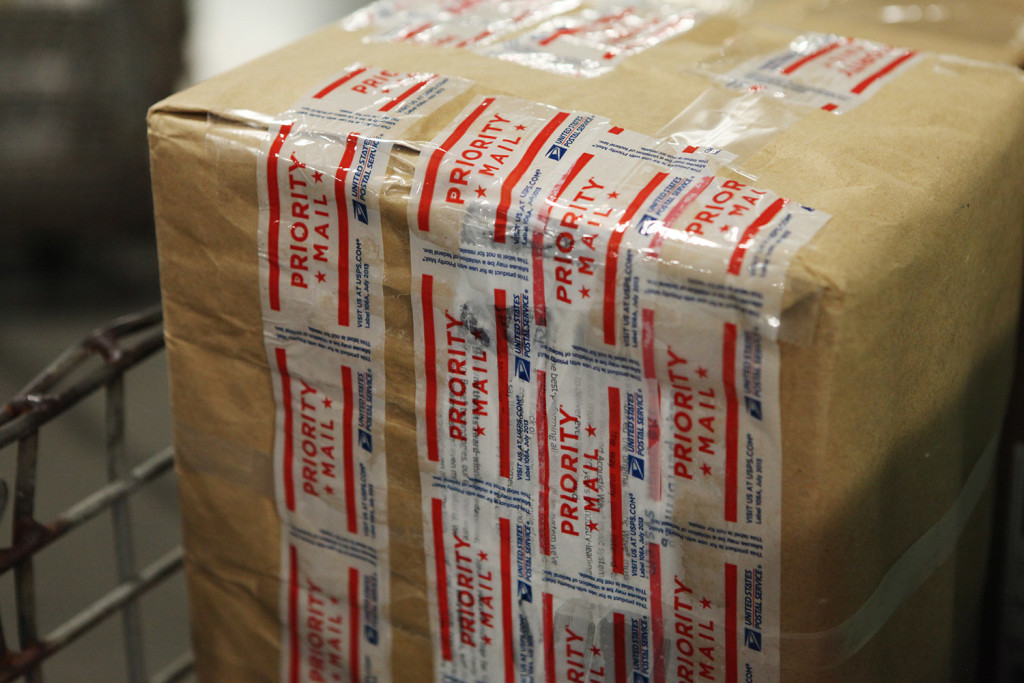 A Priority Mail package is on its way to its receiver after being processed at the Postal Service's sorting facility in Scarborough. Shift changes at the plant have delayed processing of mail in recent days.