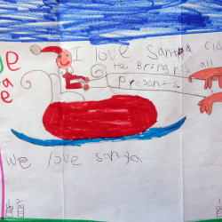 This letter writer drew a picture on her letter to Santa that was one of many being answered by volunteers at the Main Post Office in Portland on Monday.