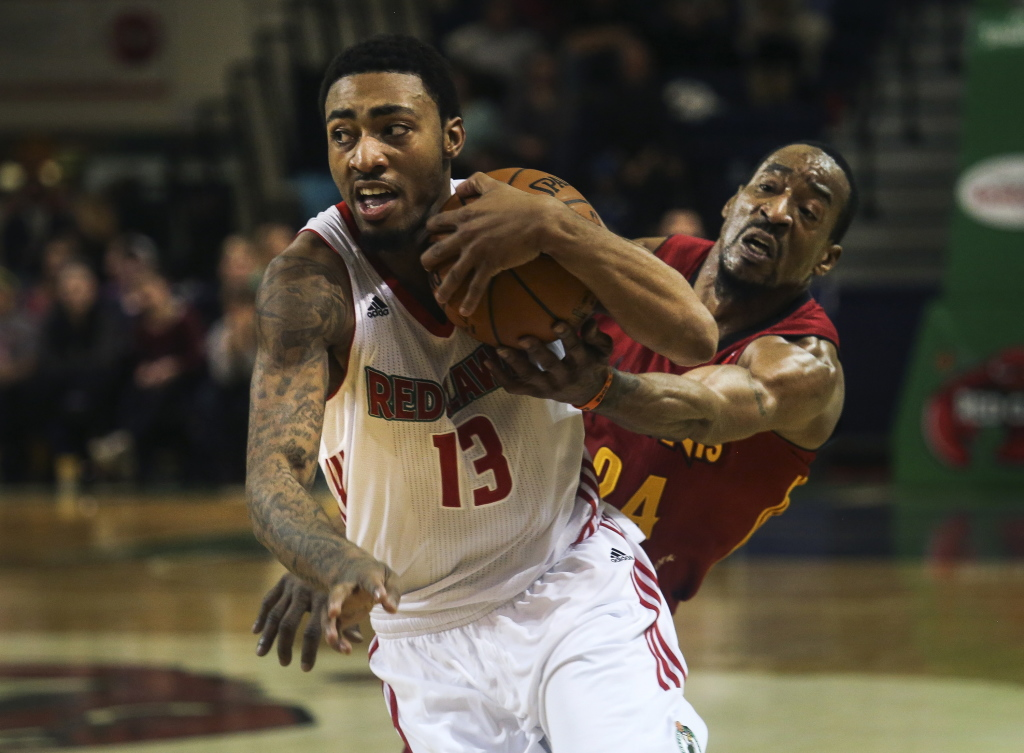 James Young, a Celtics first-round choice who scored 31 points Thursday night, muscles past Chris Porter of the Fort Wayne Mad Ants in a 110-106 victory at the Expo. Whitney Hayward/Staff Photographer
