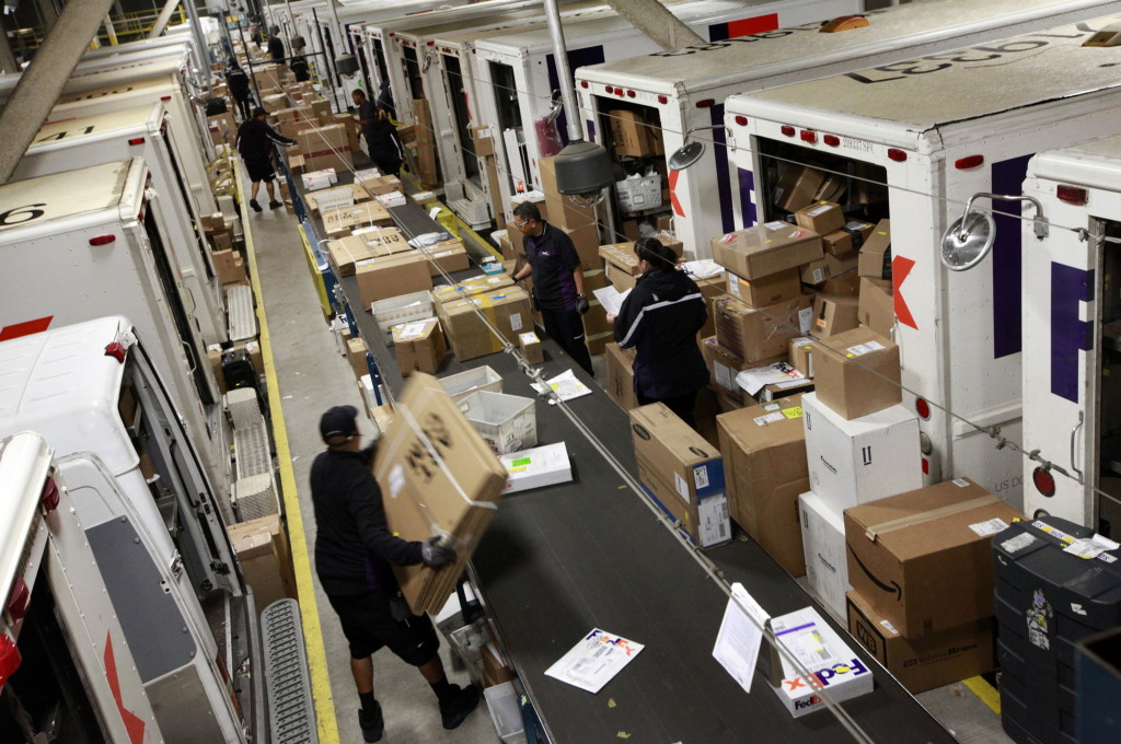 FedEx workers tag and sort packages Dec. 15, the busiest shipping day of the year, at a FedEx facility in San Francisco, Calif. Laura A. Oda/Bay Area News Group/Tribune News Service