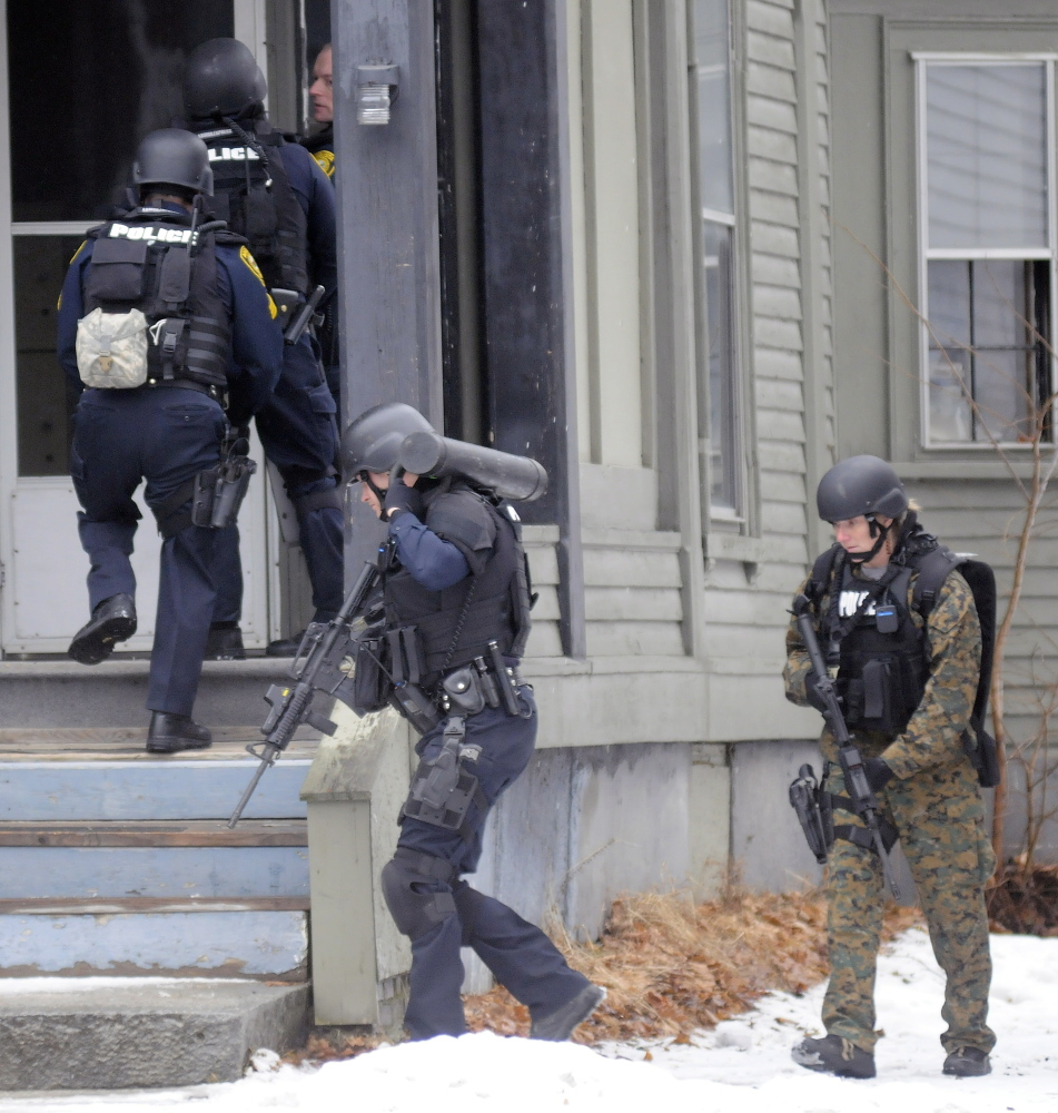 Augusta police tactical team members enter 388 Water St. to apprehend Lorne Sherwood on Tuesday. Andy Molloy/Kennebec Journal