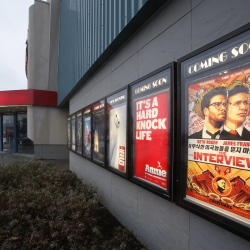 "A poster for ""The Interview"" is displayed outside Cinemagic in Westbrook on Wednesday. Sony Pictures Entertainment has canceled the Christmas release of the Seth Rogen comedy because of the threats. Gregory Rec/Staff Photographer"