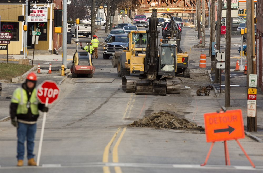 Construction crews do sewer work on Elm Street in Biddeford last month. Although some road repair and sewer projects are in the city's budget, officials say additional work needs to be done on 35 miles of roads and stormwater-sewer line separation.