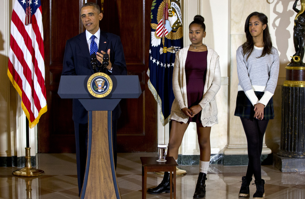A Republican congressional staffer resigned Monday after criticizing Malia Obama, right, and Sasha Obama for their appearance at last week's turkey-pardoning ceremony.