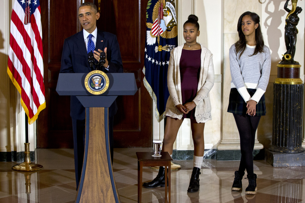 President Barack Obama, joined by his daughters Malia, right, and Sasha, center, speaks at the White House on Nov. 26 during the presidential turkey pardon ceremony, an annual Thanksgiving tradition.