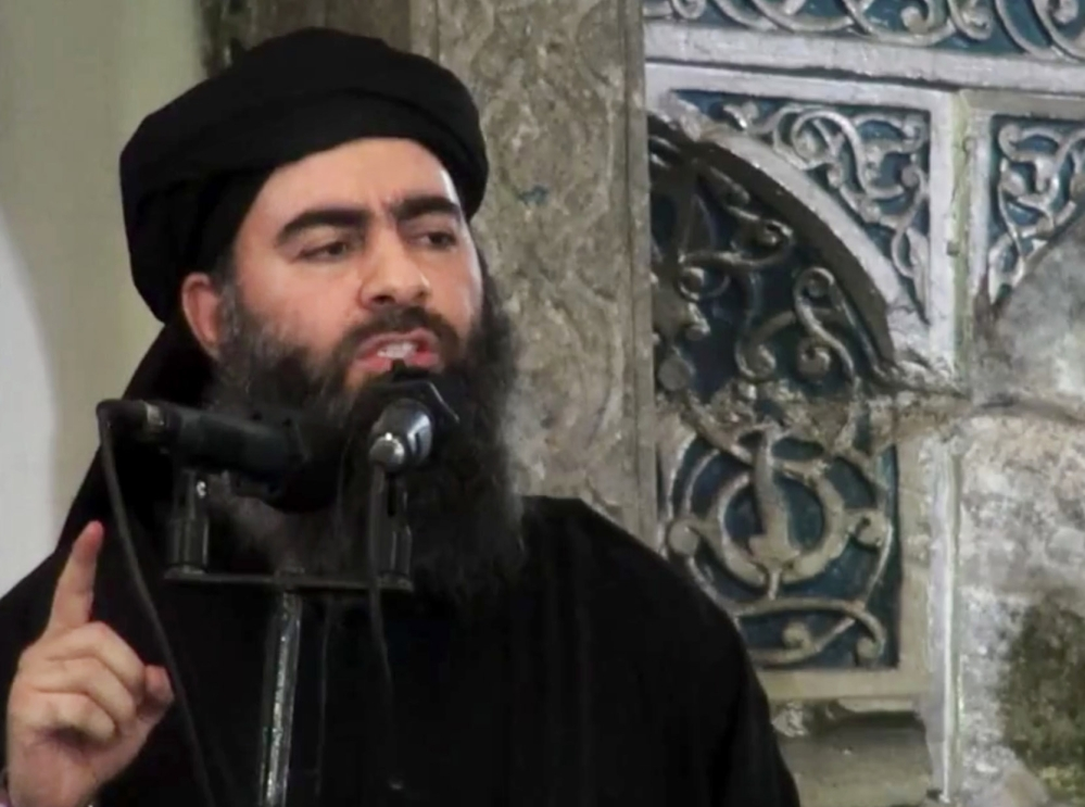 This file image made from video posted on a militant website Saturday, July 5, 2014, which has been authenticated based on its contents and other AP reporting, purports to show the leader of the Islamic State group, Abu Bakr al-Baghdadi, delivering a sermon at a mosque in Iraq.