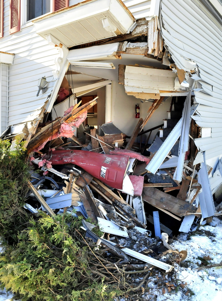 A three-unit Madison Avenue building in Skowhegan shows damage after a tractor-trailer struck the structure on Tuesday. The driver was treated at the scene for a minor injury.