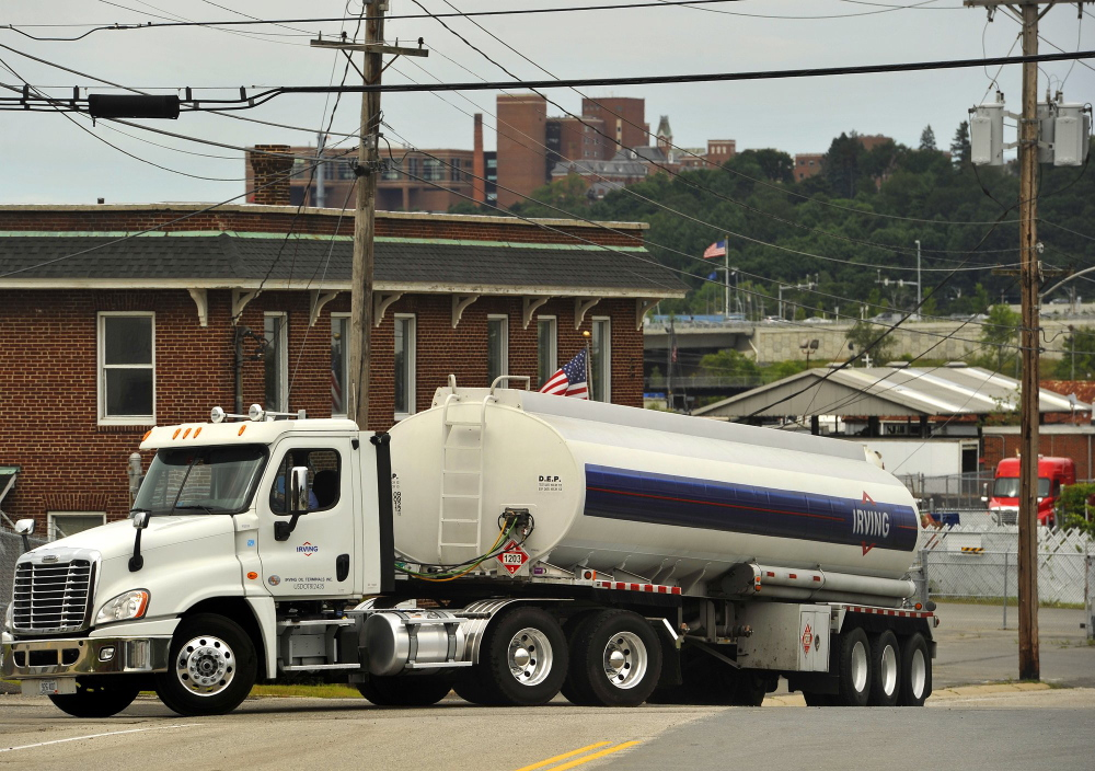 Oil trucks load and unload at terminal facilities in South Portland. The drop in the price of heating oil makes it competitive with natural gas.