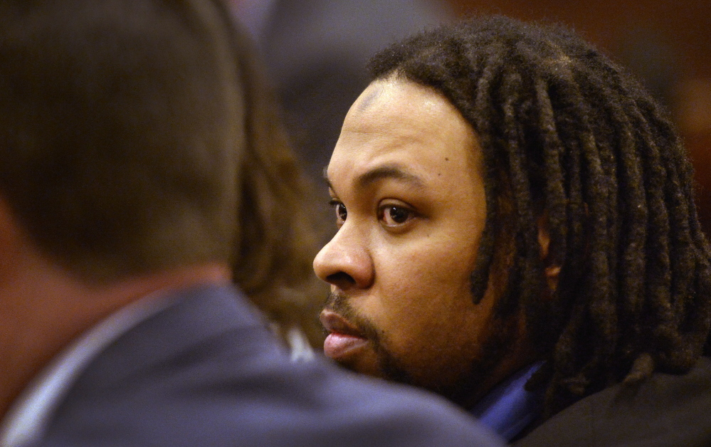 Tareek Hendricks, charged with fatally stabbing Robert Stubbs of Westbrook and injuring his wife, Melissa, appears at the Cumberland County Courthouse for opening statements in his trial Tuesday.