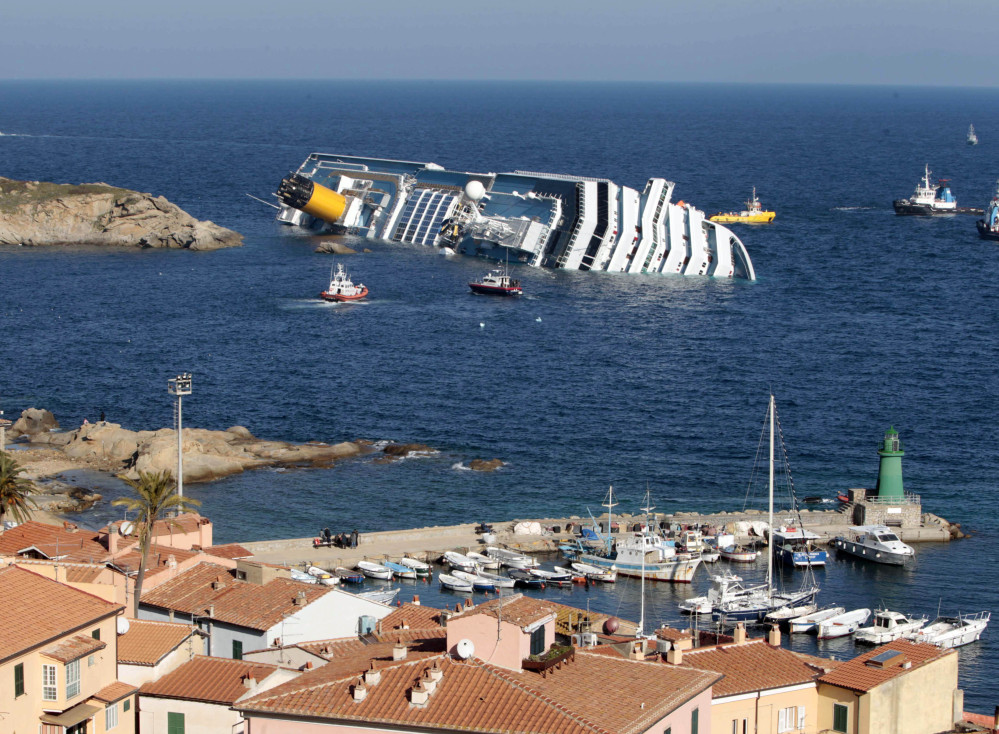 The cruise ship Costa Concordia rests on its starboard side after running aground in 2012 on the tiny Tuscan island of Giglio, Italy. The accident left 32 people dead.