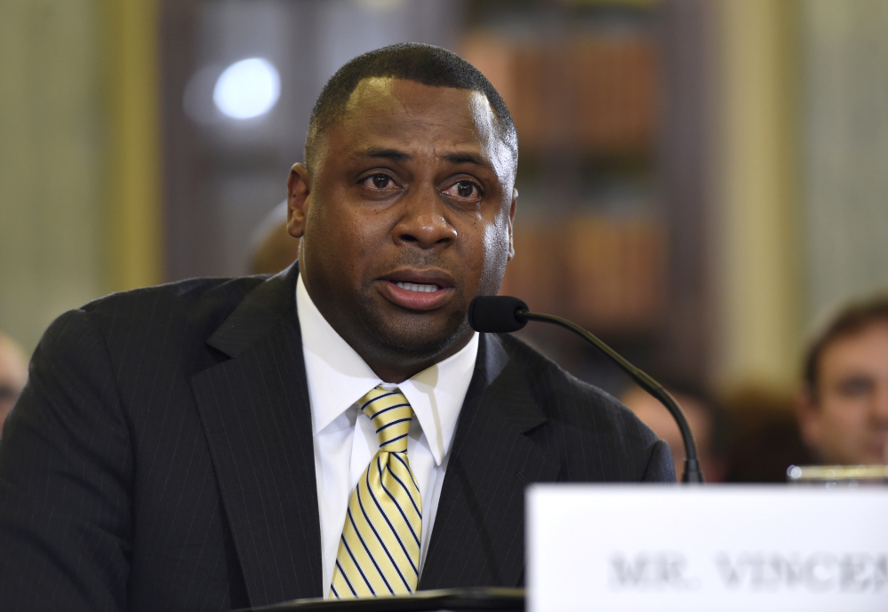 "NFL Executive Vice President of Football Operations Troy Vincent testifies Tuesday before the Senate Commerce Committee on domestic violence in professional sports. Vincent, a former player, choked up while testifying, saying abuse was a ""way of life"" in his home when he was growing up because his mother was beaten."