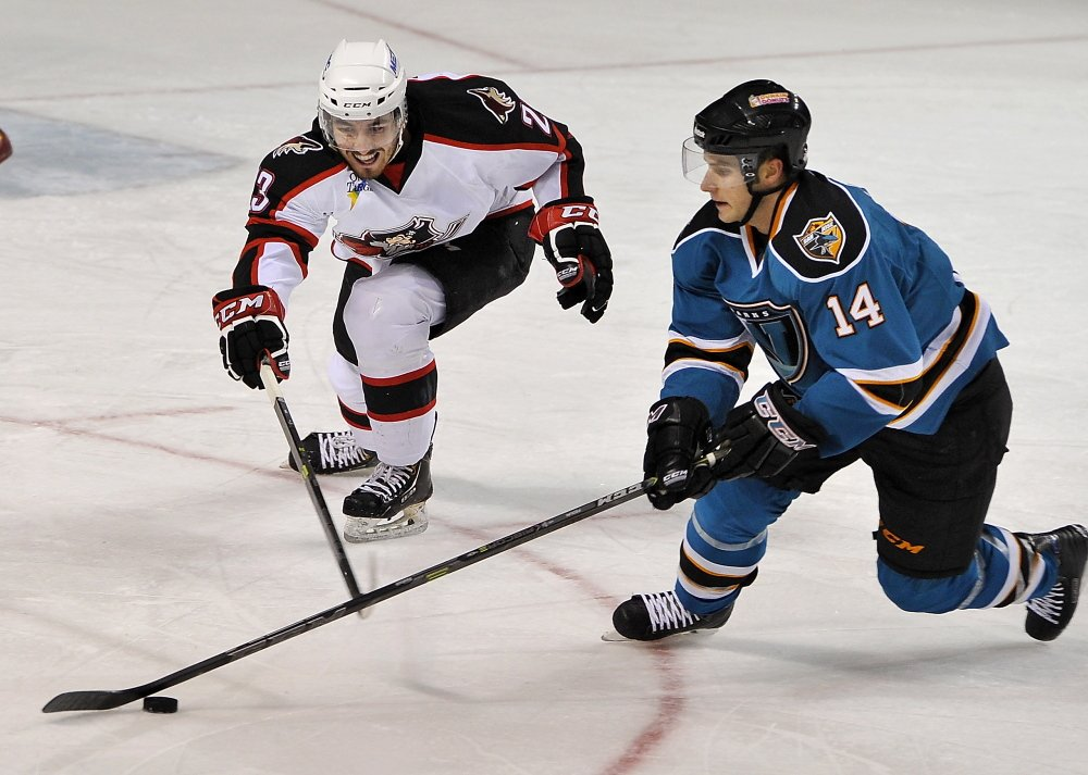 Portland's Joel Hanley goes after Worcester's Taylor Fedun as the Portland Pirates host the Worcester Sharks in AHL hockey action at the Cross Insurance Arena Tuesday.