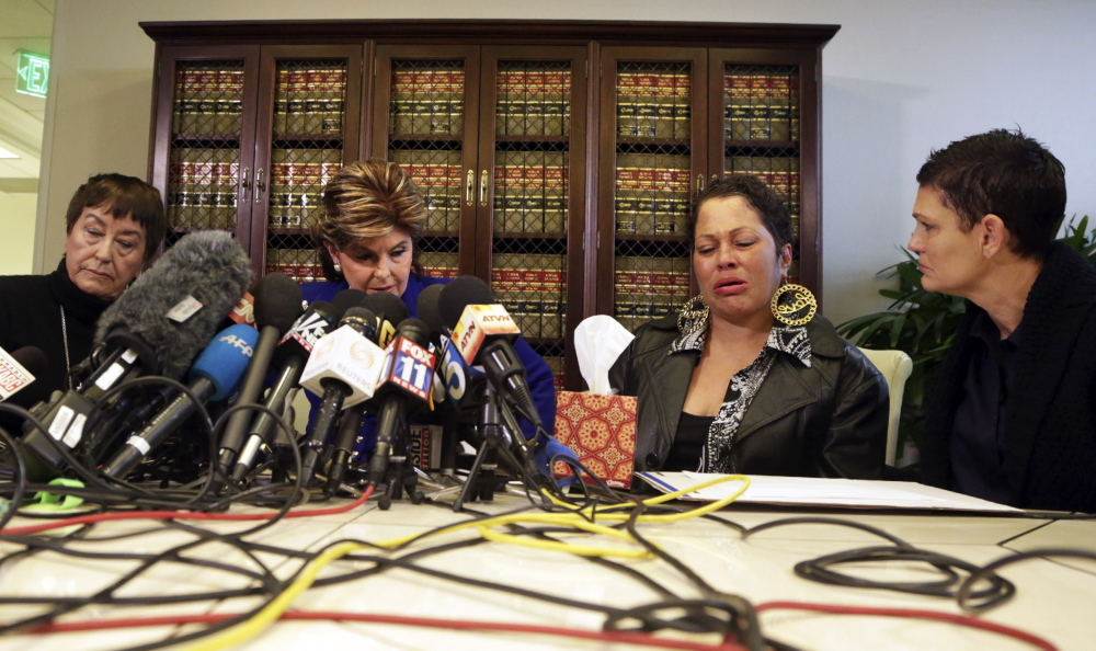 Second from right, a woman who provided only her first name, Chelan, talks about her encounters with Bill Cosby in the 1980s. Also attending the Los Angeles news conference are, from left, Cosby accuser Helen Hayes, attorney Gloria Allred and accuser Beth Ferrier.