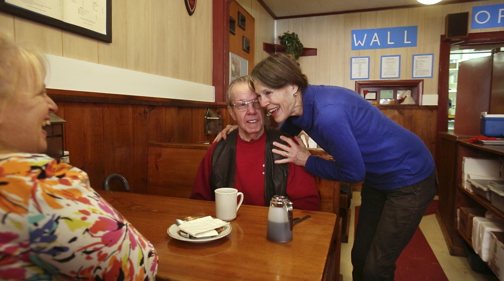 Ebb Tide co-owner Nancy Gilchrist hugs longtime customer Milt Van Vlack on Thursday as she and her husband, Peter, prepare to close the restaurant after operating it 40 years.