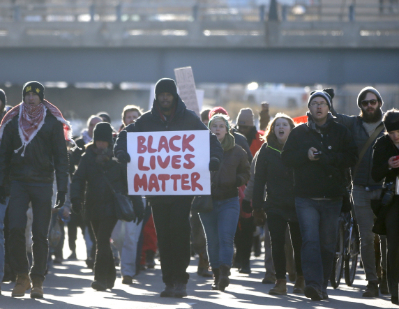 Protesters march in Minneapolis on Thursday, a day after a grand jury decided not to indict a New York City officer in the death of Eric Garner.