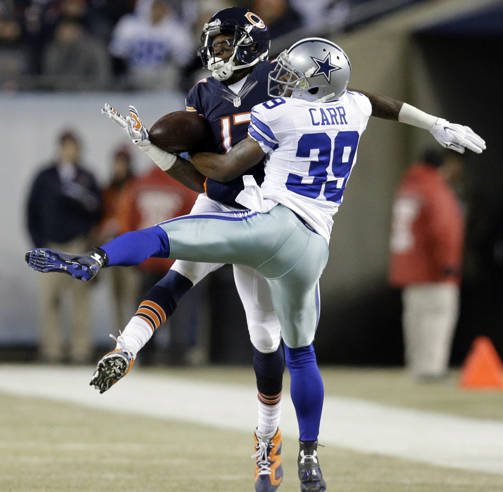 Brandon Carr of the Dallas Cowboys breaks up a pass intended for Alshon Jeffery of the Chicago Bears in the first half of the Cowboys' 41-28 victory Thursday night.