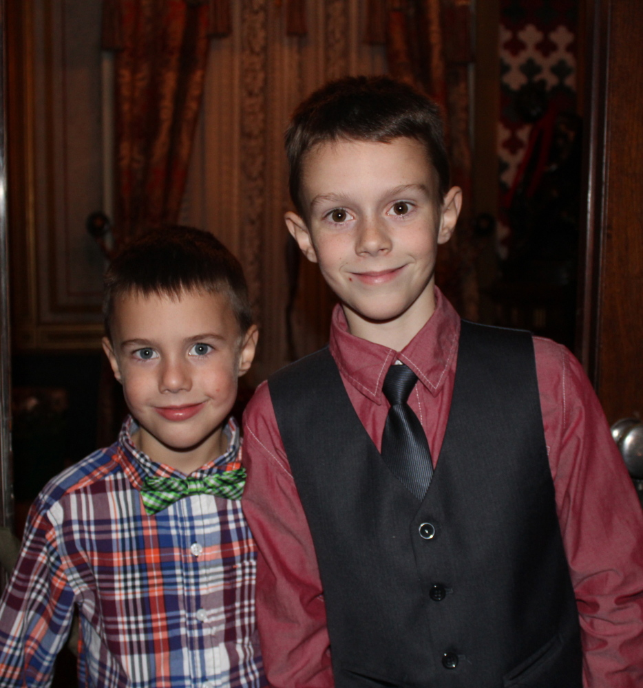 Brothers Ben and Jack Caron, whose mother Heather Caron designed the holiday decor for the staircase.
