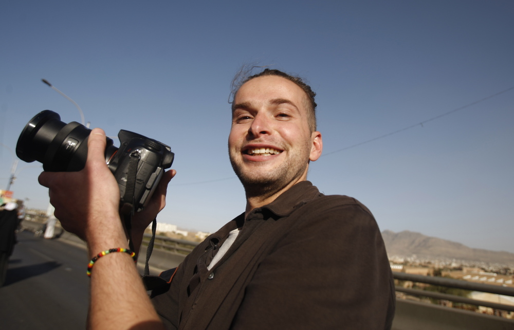 Luke Somers, 33, an American photojournalist who was kidnapped over a year ago by al-Qaida, poses for a picture during a parade marking the second anniversary of the revolution in Sanaa, Yemen in February, 2013. Somers was killed Saturday in a failed rescue attempt.