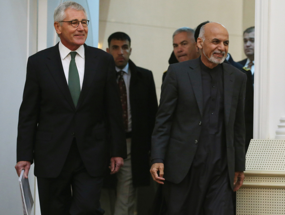 Afghan President Ashraf Ghani, right and and U.S. Secretary of Defense Chuck Hagel walk into a news conference at the Presidential Palace on Saturday in Kabul, Afghanistan. Defense Secretary Hagel spoke about troop withdrawal in Afghanistan and the recent failed attempt to rescue an American hostage in Yemen.