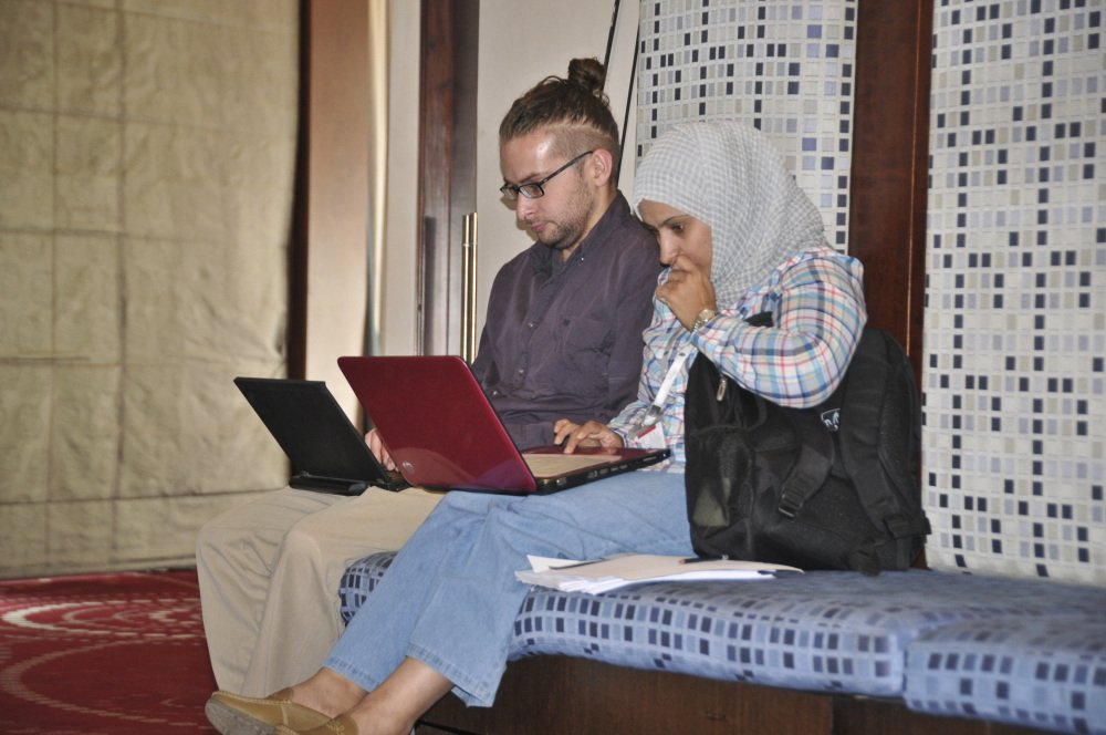 This photo taken on July, 17, 2013 shows American photojournalist Luke Somers, left, at work in Sanaa, Yemen, before he was captured by al-Qaida.