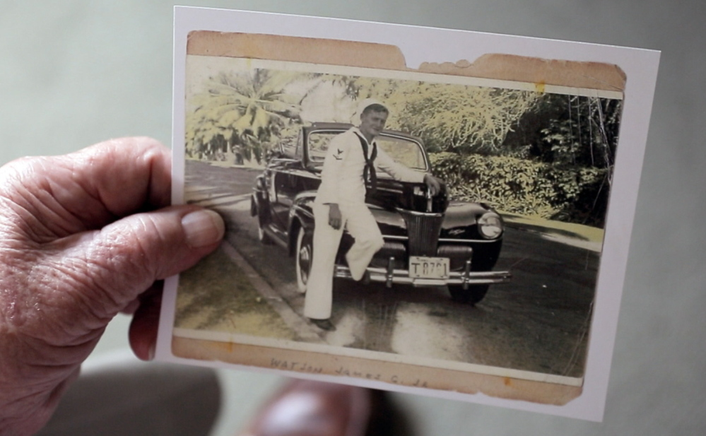 Watson shows a photo of himself when he served in the Navy during World War II. On the day of the Pearl Harbor attack, Watson was aboard the USS Phoenix, which was anchored away from Battleship Row, where the Japanese inflicted the most destruction.