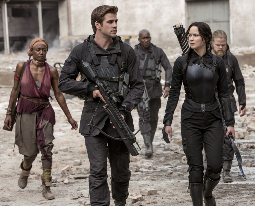 "Liam Hemsworth and Jennifer Lawrence appear in a scene from Lionsgate's ""The Hunger Games: Mockingjay – Part 1."""