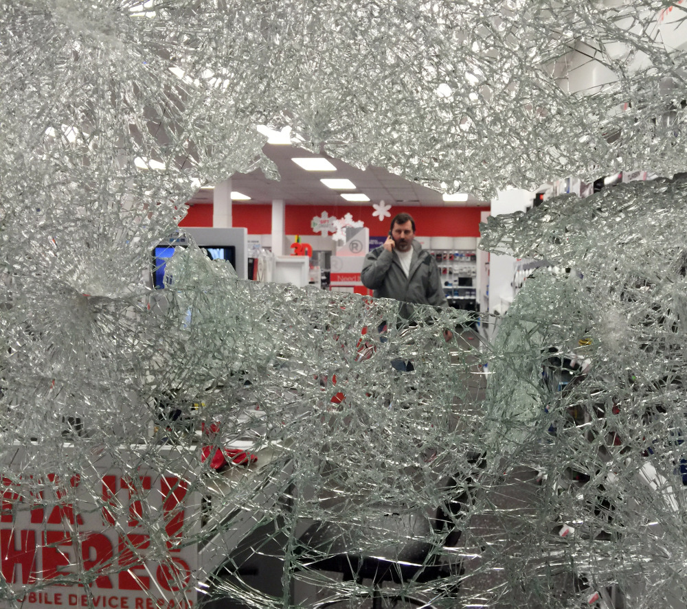 "Protesters smashed a window of this Radio Shack in Berkeley and looted the store. A witness said about three dozen people cheered when the window broke. ""The whole peaceful protest thing went out the window,"" Aakash Agarwal said."