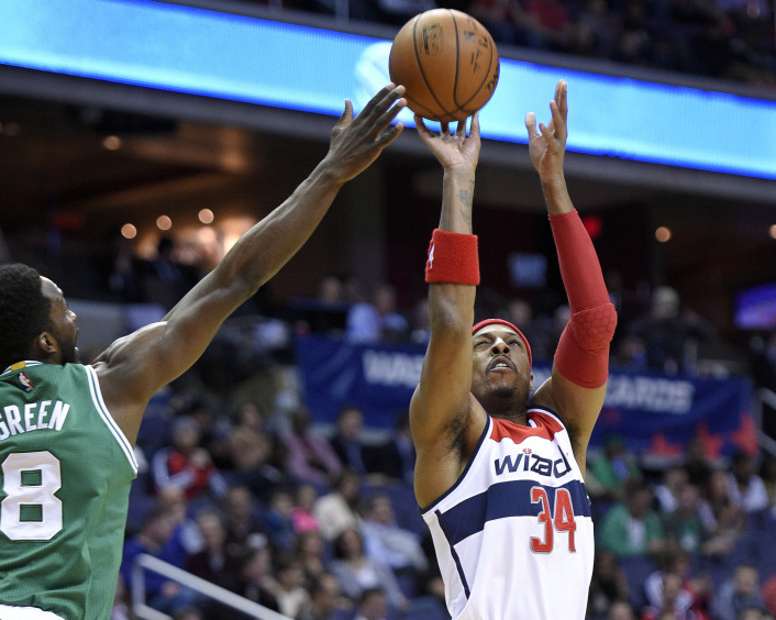 Washington Wizards forward Paul Pierce takes a shot against Celtics forward Jeff Green during the first half of Monday night's game in Washington. Pierce scored a season-high 28 points against his former team in the Wizards' double overtime win.
