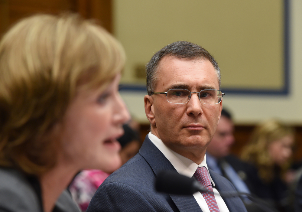 MIT economist Jonathan Gruber, right, listens as Marilyn Tavenner, the administrator of the Centers for Medicare and Medicaid Services, testifies on Capitol Hill in Washington on Tuesday.