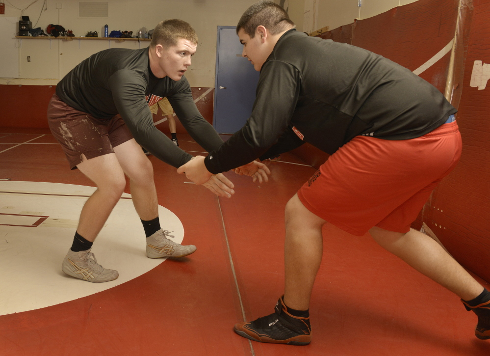 """Wells senior Michael Curtis, left, who is practicing with Ben Orozco, has won two Class B championships and also the inaugural New England qualifier last year. What's the secret to his success? """"It's really hard to be really good without practice,"""" Curtis says."""