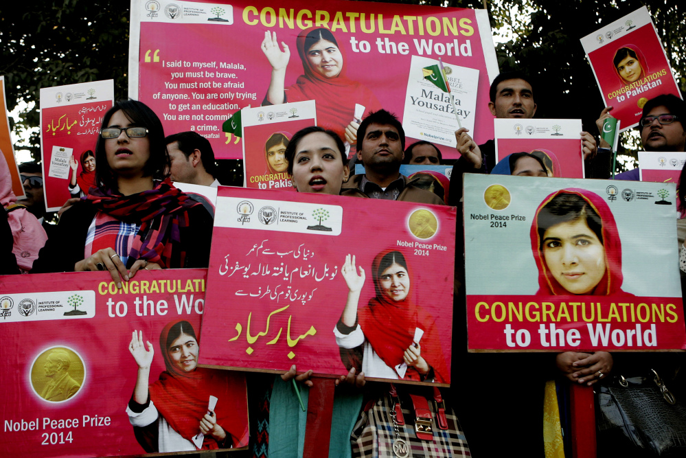 Pakistani students pay tribute to Nobel Peace Prize laureate Malala Yousafzai in Lahore, Pakistan, Wednesday.
