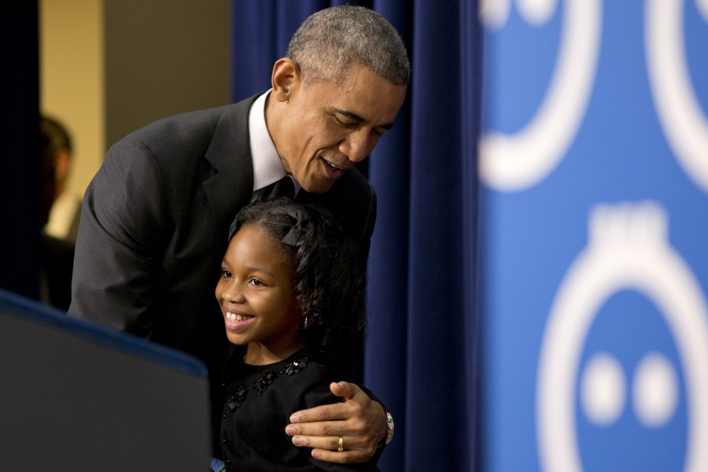 President Barack Obama hugs Alajah Lane, 9, of Washington, after she introduced him at the White House on Wednesday, when he spoke about early childhood education.