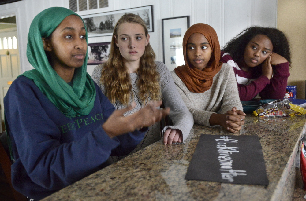 Senior Muna Mohamed, junior Chandler Clothier, junior Iman Abdalla and senior Kalgaal Issa are among the Lewiston High School students who created a poster calling for racial justice.