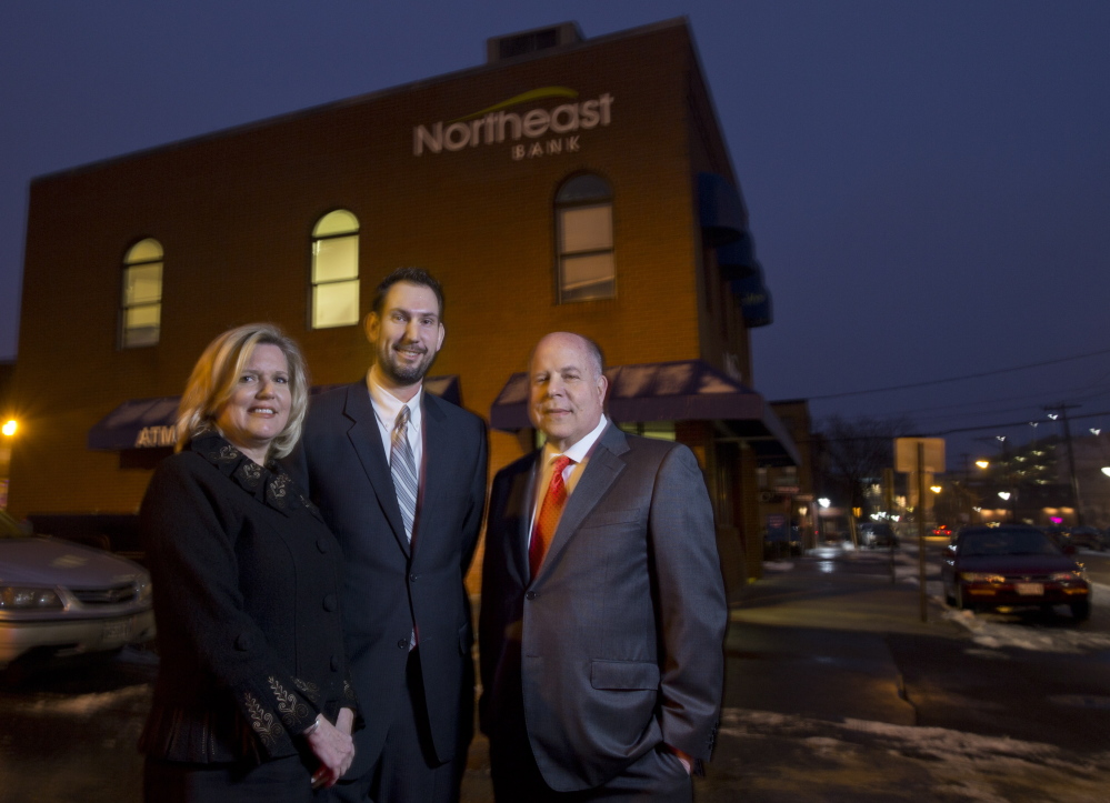 The launching of Northeast Bank's small-business loan division is being led by, from left, executives Jeanne Hulit, Jonathan Smith and Richard Wayne. The Lewiston-based bank has a branch at 77 Middle St. in Portland, above.