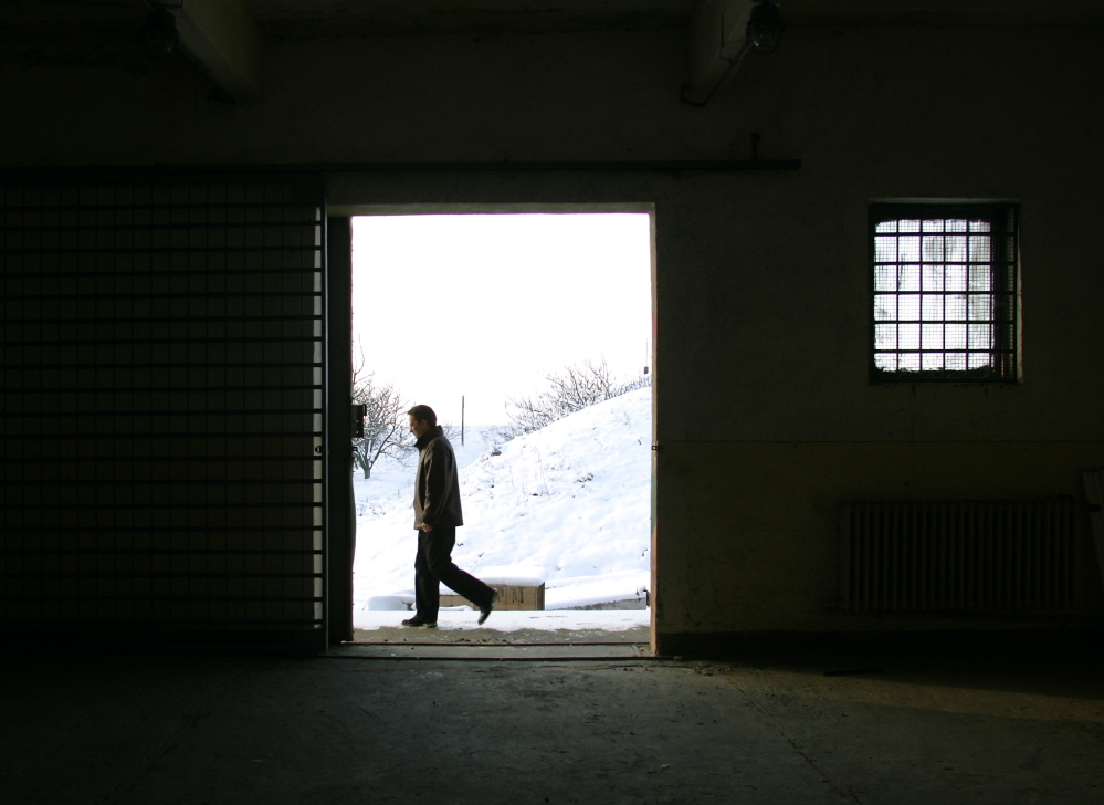 A journalist walks past a building inside the Mihail Kogalniceanu Airbase in Bucharest, Romania, in 2005. The airbase was indicated by Human Rights Watch as a possible location for a covert CIA prison allegedly used to interrogate terrorist suspects.