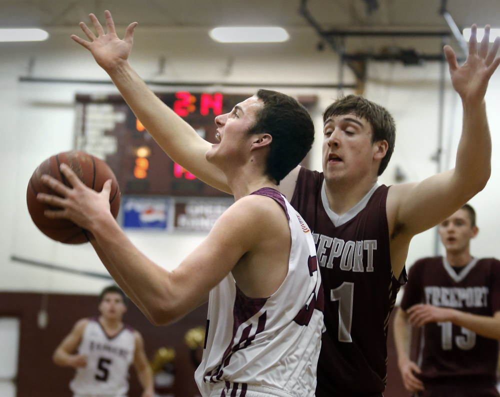 Greely's Matt McDevitt drives past Freeport's Matt Nielsen. McDevitt, a sophomore, led the victorious Rangers with 18 points, and will be counted upon this season to help preserve Greely's rich tradition.