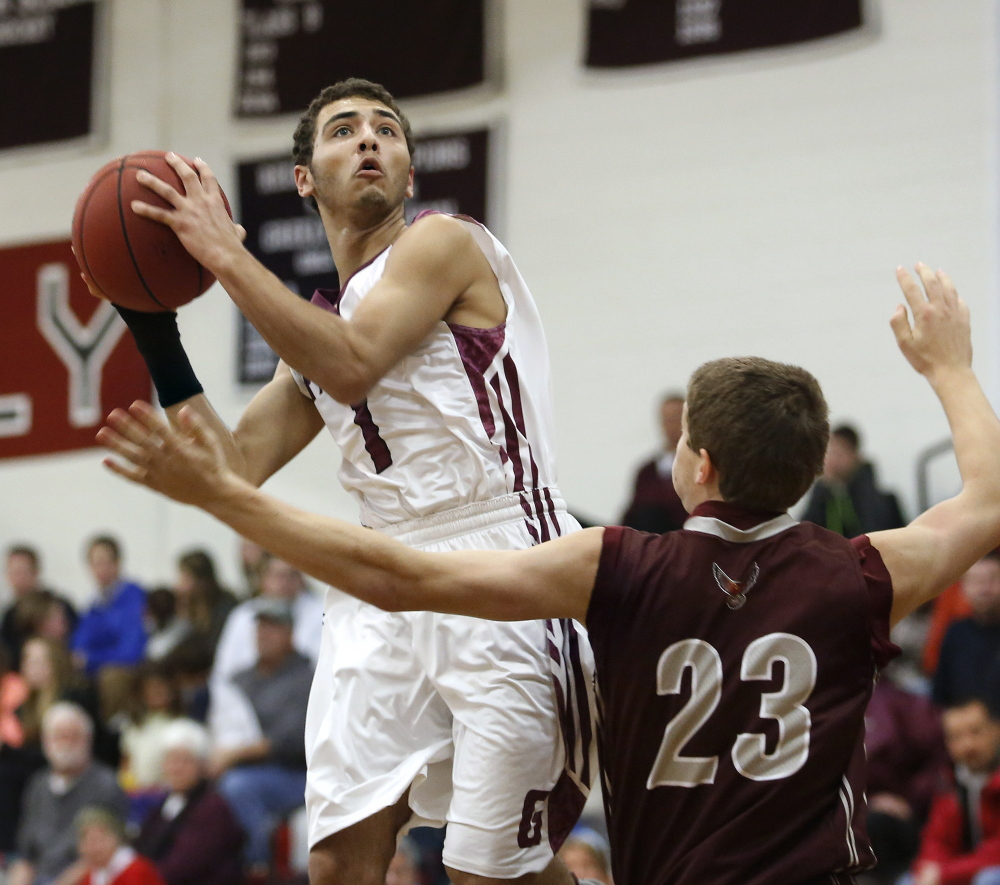 Greely's Gabe Axelsen looks to shoot over Freeport's Jack Davenport in Wednesday night's game in Cumberland, won by the Rangers.