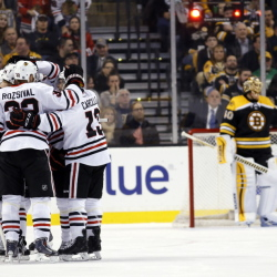 Chicago Blackhawks surround defenseman Klas Dahlbeck (not pictured) after scoring a goal on Boston Bruins goalie Tuukka Rask during the first period Thursday night at TD Banknorth Garden in Boston.
