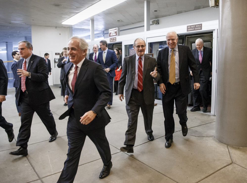 The Associated Press From left, Sen. Mark Pryor, D-Ark., Sen. Bob Corker, R-Tenn., Sen. James Risch, R-Idaho, Sen. John McCain, R-Ariz., and Sen. Orrin G. Hatch, R-Utah, rush to the Senate floor on Capitol Hill in Washington for a procedural vote to advance the defense bill Thursday. The bill passed Friday.